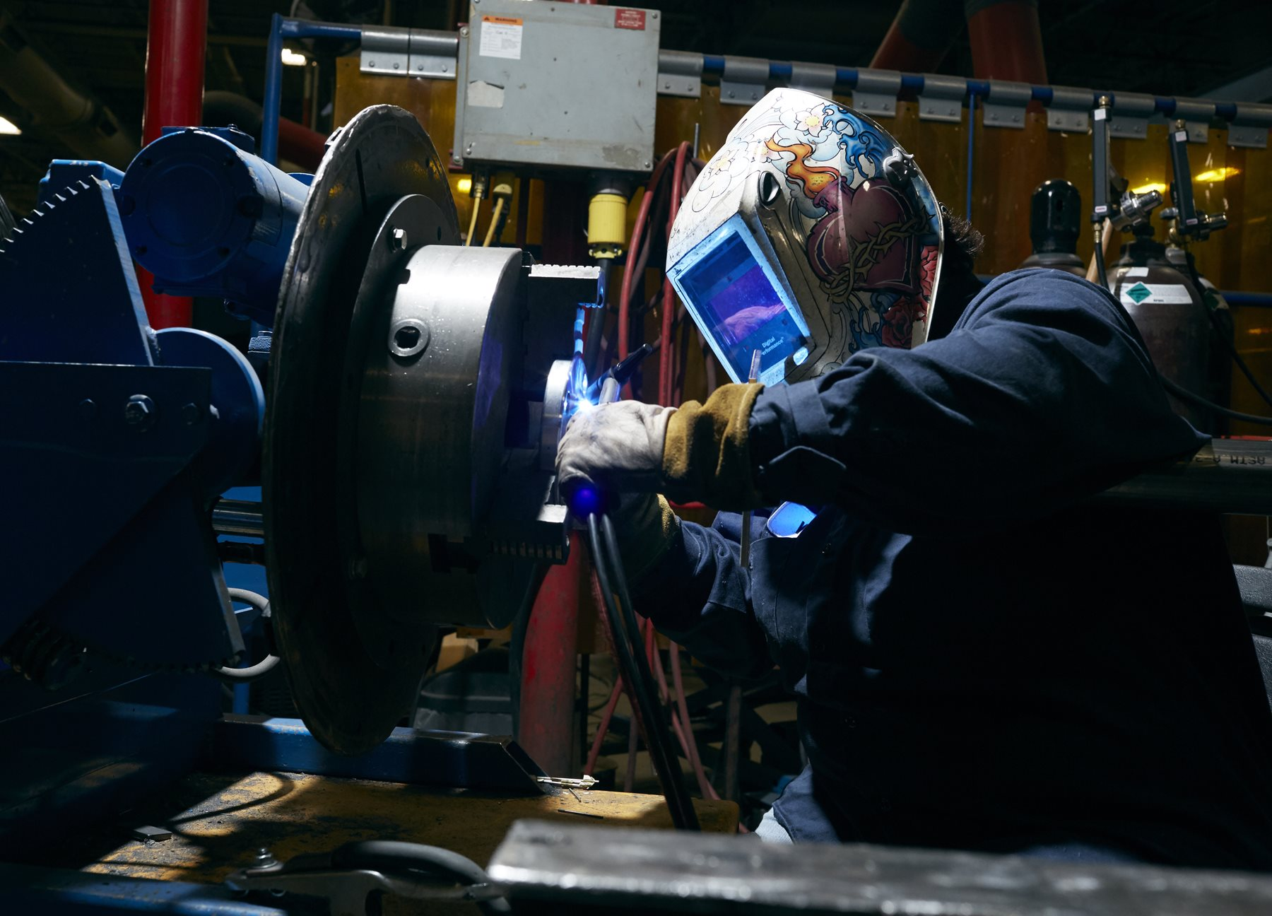 A John Zink Hamworthy Combustion (JZHC) welder works on equipment used to control emissions, much like Morning Star uses.