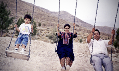 Saad swings with his parents